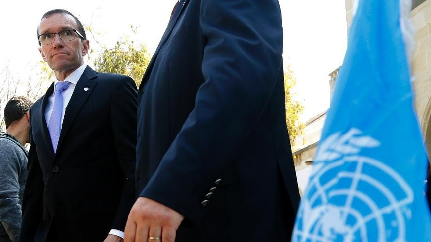 "United Nations envoy for Cyprus, Norway's Espen Barth Eide leaves the presidential palace after a meeting with Cyprus' president Nicos Anastasiades in divided capital Nicosia, Tuesday, March 17, 2015. Eide said the reasons that led to a halt in talks may be over and that gas developments could create ""a climate where talks can continue."" (AP Photo/Petros Karadjias)"