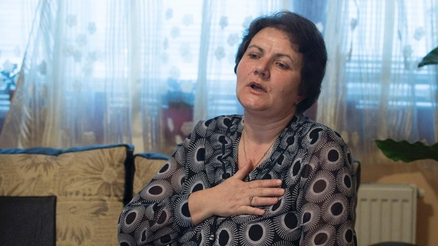 """In this photo taken on Friday March 6, 2015 in Sarajevo, Bosnia, Muslim Bosniak woman Suhra Sinanovic  reacts as she talks about her husband Muriz Sinanovic who had been killed in July 1995 Srebrenica massacre. Serbia arrested men accused of executing over 1,000 Muslims at the warehouse on the outskirts of Srebrenica, The Associated Press has learned  in Serbia's first arrests of men who carried out mass executions around the town. Serbia has put on trial men who took a group of prisoners away from Srebrenica to be killed, and in 2011 it arrested Ratko Mladic """"the warlord who masterminded the slaughter """" and sent him to The Hague, Netherlands to face an international criminal court. Arrests were Serbia's first attempt to bring to justice men who got their hands bloody in the killing machine known as the Srebrenica massacre 20 years ago this July. (AP Photo/Sulejman Omerbasic)"""