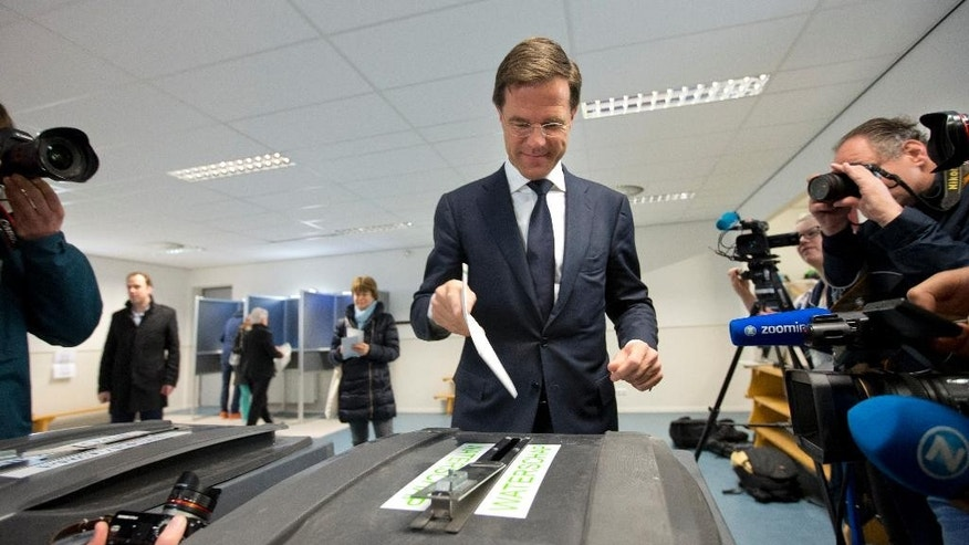Dutch Prime Minister Mark Rutte casts his ballot in The Hague, Netherlands, Wednesday, March 18, 2015. The Dutch are going to the polls to elect 12 provincial councils, in a vote that could have profound consequences for the ruling coalition of Rutte. (AP Photo/Peter Dejong)