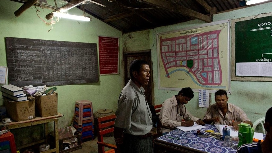 "In this March 4, 2015 photo, administration officers of Yarza Thinggyan ward write records in family household registers in Dala, suburbs of Yangon, Myanmar. In Myanmar a nearly a century old law empowers the state to decide what guests, if any, a family may have in their own home. Commonly referred as ""midnight inspections"" because they mostly occur when families sleeping, are still being employed and used to suppress dissent, and the legal architecture that facilitates them are part of a mountain of legislation, much of it in the constitution, illustrating just how much power the military legally retains despite the country's much-touted transition from junta rule. (AP Photo/Gemunu Amarasinghe)"