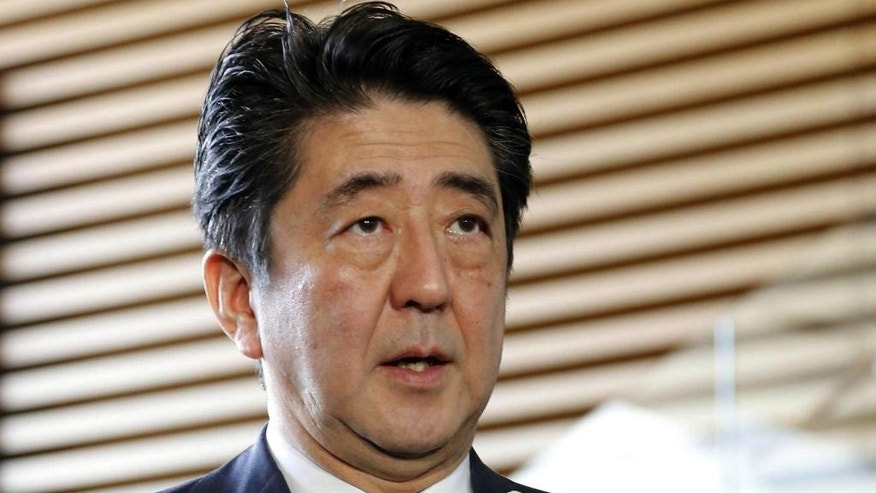 Japanese Prime Minister Shinzo Abe speaks on a museum attack in Tunisia, at his official residence in Tokyo Thursday, March 19, 2015. Japan has confirmed the deaths of three of its nationals in the attack on tourists in Tunisia. Abe told reporters in Tokyo on Thursday that three other Japanese were injured. (AP Photo/Kyodo News) JAPAN OUT, MANDATORY CREDIT