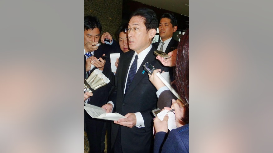 Japanese Foreign Minister Fumio Kishida, center, answers to a reporter's question on a museum attack in Tunisia, at Foreign Ministry in Tokyo Thursday, March 19, 2015. Japan has confirmed the deaths of three of its nationals in the attack on tourists in Tunisia. (AP Photo/Kyodo News) JAPAN OUT, MANDATORY CREDIT