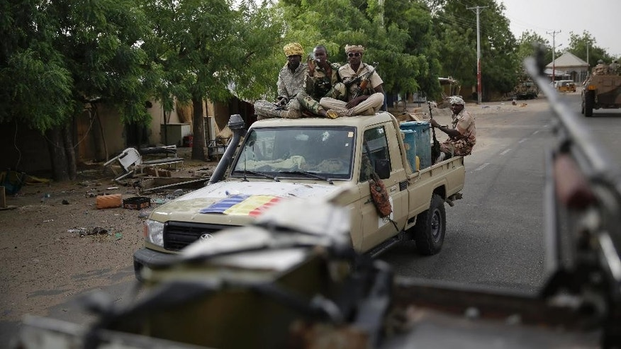 Chadian soldiers ride on trucks and pickups in the city of Damasak, Nigeria, Wednesday, March 18, 2015. Damasak was flushed of Boko Haram militants last week, and is now controlled by a joint Chadian and Nigerien force. (AP Photo/Jerome Delay)
