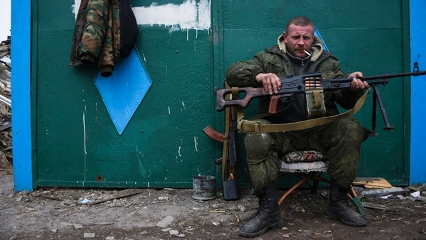 FILE - In this Thursday March 12, 2015 file photo, a pro-Russian rebel rests at the frontline in a village not far from Luhasnk, eastern Ukraine. (AP Photo/Mstyslav Chernov, File)