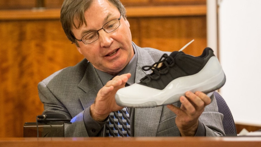 Herbert Hedges, a Nike shoe expert, testifies during former New England Patriots football player Aaron Hernandez's murder trial, Tuesday, March 17, 2015, in Fall River, Mass. Hernandez is charged with killing semiprofessional football player Odin Lloyd. (AP Photo/The Boston Globe, Aram Boghosian, Pool)