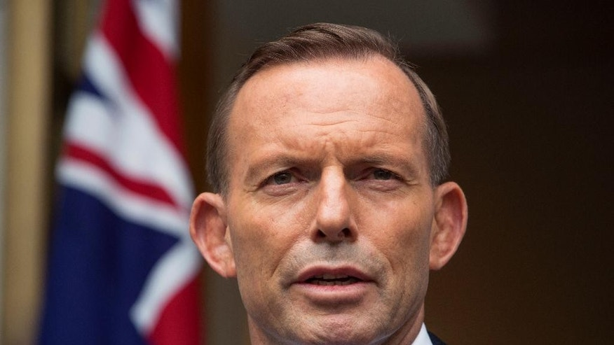 FILE - In this Feb. 9,. 2015 file photo, Australian Prime Minister Tony Abbott answers questions at a media conference before attending the parliament's question time in Canberra. Australia's gaffe-prone prime minister took back his second Nazi-related comment in a month on Thursday, March 19 after he compared the opposition party leader to German World War II-era propaganda minister Joseph Goebbels. (AP Photo/Andrew Taylor, File)