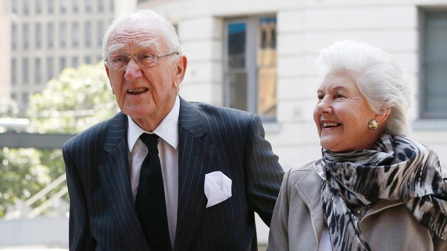 FILE - In this Nov. 4, 2014 file photo, former Australian Prime Minister Malcolm Fraser, left, arrives at Town Hall with his wife Tamie for a memorial service for former Australian Prime Minister Gough Whitlam in Sydney. Malcolm Fraser, the former Australian prime minister who was notoriously catapulted to power by a constitutional crisis that left the nation bitterly divided, died on Friday, March 20, 2015 his office said. He was 84. (AP Photo/Jason Reed, File)