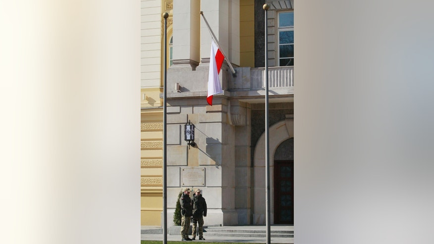 Poland's national white-and-red flag flying at half-staff on the Belweder Palace of Polish President Bronislaw Komorowski in Warsaw, Poland on Thursday, March 19, 2015, in a sign of mourning for  Poles killed and injured in the armed attack on a museum in the Tunisian capital of Tunis on Wednesday. Officials said that two Poles were confirmed killed,  and others were hospitalized, but stressed the figures could change as Tunisian officials were still identifying the victims. (AP Photo/Czarek Sokolowski)