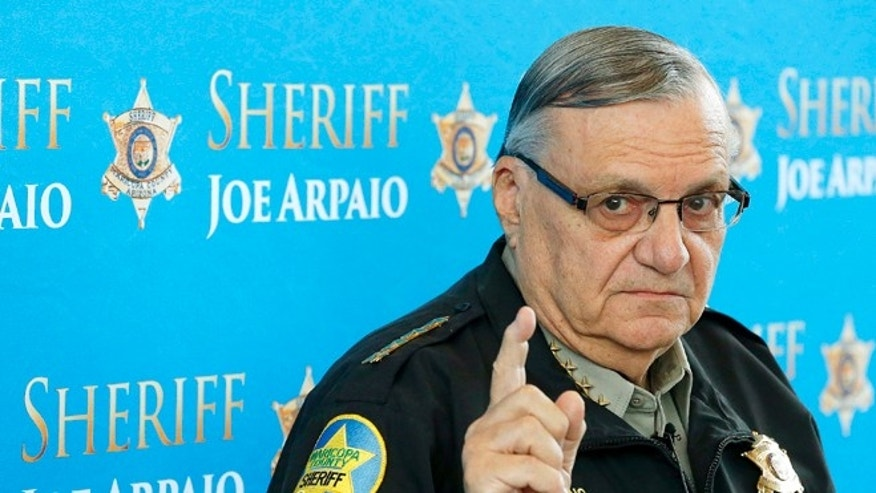 FILE - In this Dec. 18, 2013, file photo, Maricopa County Sheriff Joe Arpaio speaks at a news conference at Maricopa County Sheriff's Office Headquarters in Phoenix. The Arizona sheriff known for clashing with the federal government and cracking down on illegal immigration will face a civil contempt-of-court hearing because his office repeatedly violated orders issued in a racial-profiling case, a U.S. judge said Thursday, Feb. 12, 2015. (AP Photo/Ross D. Franklin, File)