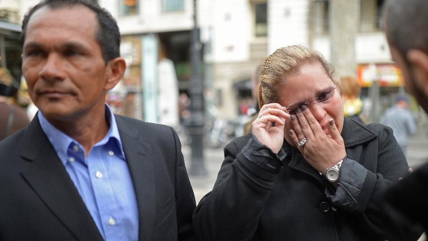 "Giovana, right and Hector Gonzalez, both from Nicaragua, talk, during an interview with The Associated Press after surviving the attack at Tunis' National Bardo Museum, at the Las Ramblas boulevard in Barcelona, Spain, Friday, March 20, 2015. Miami resident Giovana Gonzalez had just finished a brief bathroom break at the end of a museum tour when ""shooters started shooting everybody."" ""Everyone ran in different directions,"" Gonzalez told The Associated Press after disembarking from her cruise ship Friday in Barcelona. Gonzalez, 46, and her husband were on a cruise to celebrate their 25th wedding anniversary. Giovana and Hector Gonzalez hid behind pillars in the labyrinth-like museum for three to four hours, cringing at the sound of gunfire.  (AP Photo/Manu Fernandez)"