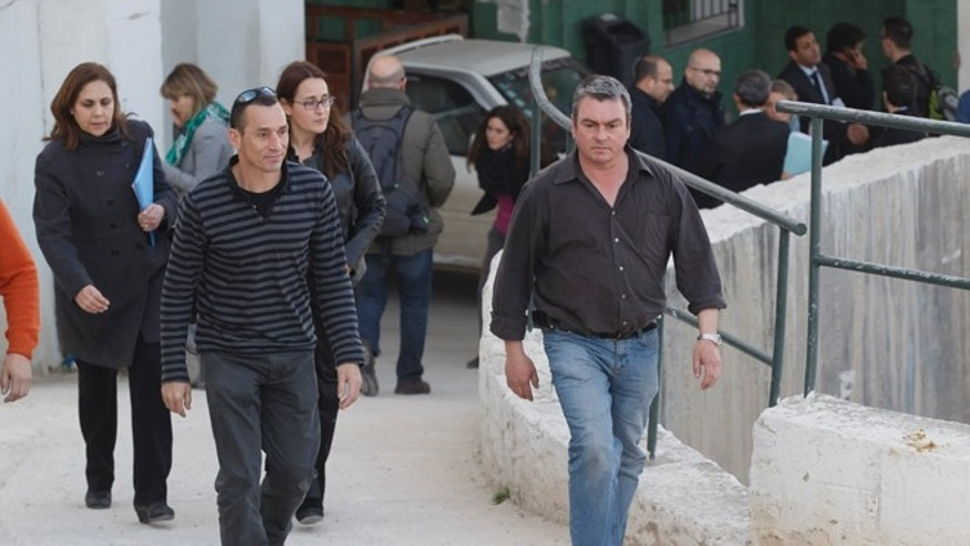 Unidentified Spanish relatives of victims of the Tunis attack leave the morgue of the Charles Nicolle hospital in Tunis Tunisia, Thursday, March 19, 2015. The radical Islamic State Group claimed responsibility Thursday for the attack on a famed Tunis museum that left 23 people dead. (AP Photo/Michel Euler)