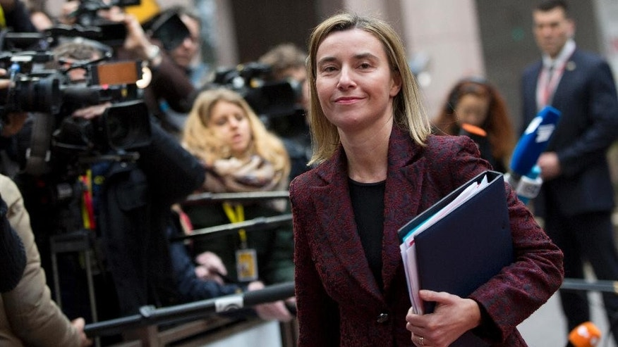 European Union High Representative Federica Mogherini arrives for an EU summit in Brussels on Thursday, March 19, 2015. Tensions over Greece's massive financial bailout overshadowed a European Union summit amid fears that the country could accidentally drop out of the euro, triggering a crisis across the currency zone shared by 19 nations. (AP Photo/Virginia Mayo)
