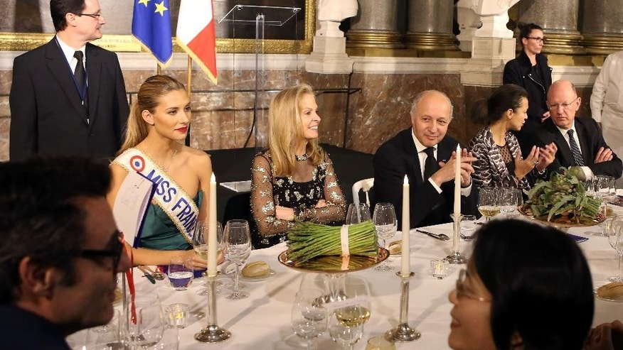 "Miss France 2015 Camille Cerf, left, U.S ambassador to France Jane D. Hartley, center, and French Foreign Minister Laurent Fabius attend a dinner at the Versailles Palace, west of Paris, Thursday March 19, 2015. The world was a symphony of popping champagne corks Thursday night, as over a thousand chefs across 5 continents celebrated the delights of French gastronomy in the first worldwide ""Good France"" event. (AP Photo/Remy de la Mauviniere)"