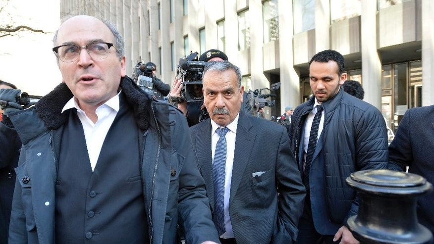 Mohammed Jaser, centre, father of Raed Jaser, leaves court after two men accused of plotting to attack a Via Rail passenger train travelling from New York to Toronto were found guilty of terror-related charges in Toronto on Friday, March 20, 2015. Raed Jaser and Chiheb Esseghaier faced a total of nine terrorism charges in connection with the plot. (AP Photo/The Canadian Press, Nathan Denette)