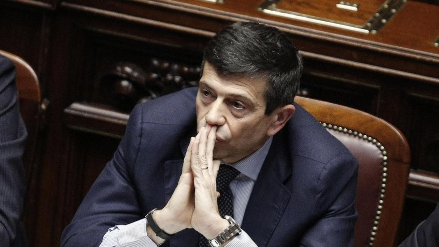 Infrastructure Minister Maurizio Lupi sits at the Lower House before announcing his resignation in Rome, Friday, March 20, 2015. Four people, including the ex-ministry official who oversaw infrastructure projects under seven governments, were ordered arrested on Monday. Prosecutors are investigating suspected corruption in connection with some of Italy's most ambitious projects, including stretches of a high-speed train line, the Italian pavilion for the world's fair that opens soon in Milan and Rome's subway expansion. Lupi told Parliament Friday he decided to step down even though he is not under investigation. He denies any wrongdoing. (AP Photo/Giuseppe Lami, Ansa) ITALY OUT
