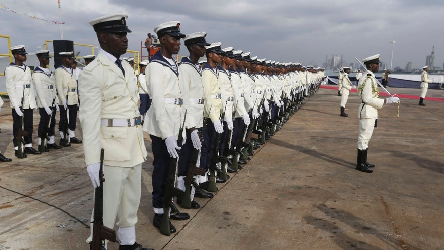 Feb. 19, 2015: Nigerian naval officers stand guard during an event to commission Warships by Nigerian President Goodluck Jonathan.