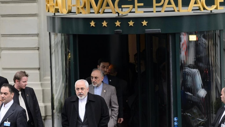 Iranian Foreign Minister Mohammad Javad Zarif leaves the hotel Beau-Rivage Palace after 5 days of bilateral meetings with U.S. Secretary of State John Kerry  during a new round of Nuclear Iran Talks, in Lausanne, Switzerland, Friday, March 20, 2015.  (AP Photo/Keystone,Laurent Gillieron)