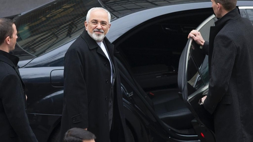 Iran's Foreign Minister Javad Zarif departs his hotel to return to Iran, following days of negotiations with United States Secretary of State John Kerry over Iran's nuclear program, in Lausanne, Switzerland, Friday, March 20, 2015.  Talks are schedule to resume next week. (AP Photo/Brian Snyder, pool)