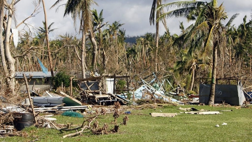 Former staff homes at the Manua Centre School lie in ruin on the island of Efate, Vanuatu, on Saturday, March 21, 2015. A week after Cyclone Pam tore through the South Pacific archipelago with winds of 270 kilometers (168 miles) per hour, people are focused on the task of rebuilding. (AP Photo/Nick Perry)
