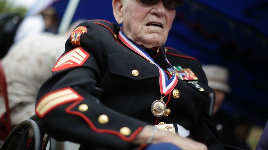 A U.S. veteran with uniform attends a ceremony commemorating the 70th anniversary of the Battle of Iwo Jima, now known officially as Ioto,  Japan Saturday March 21, 2015. (AP Photo/Eugene Hoshiko)
