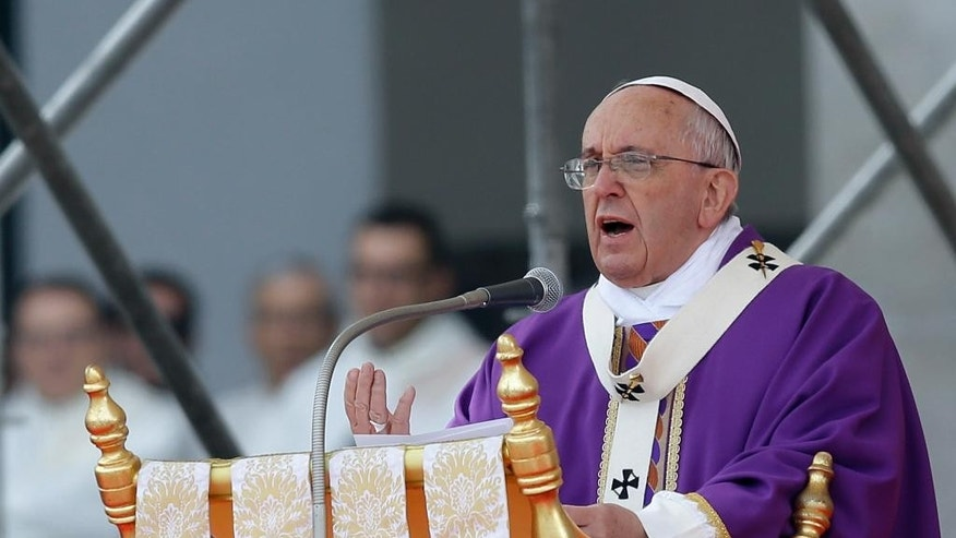Pope Francis celebrates a Mass in Naples, Italy, Saturday, March 21, 2015. Pope Francis made an impassioned defense of the unemployed during a speech to people in the poor Neapolitan neighborhood of Scampia Saturday. (AP Photo/Gregorio Borgia)