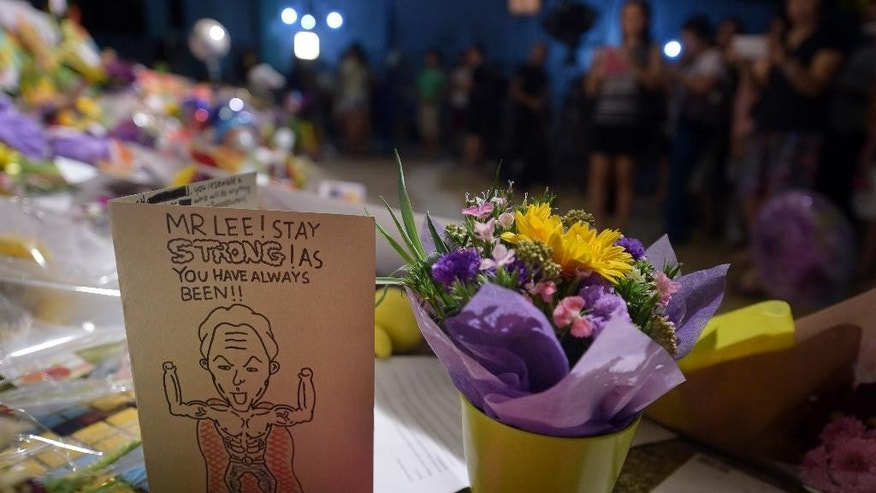 Cards and flowers are left to wish Lee Kuan Yew well at a hospital where he has been treated for the last 6 weeks on Saturday, March 21, 2015 in Singapore. The health of Lee Kuan Yew, Singapore's 91-year-old founding father, has further deteriorated, the government said Saturday. (AP Photo/Joseph Nair)