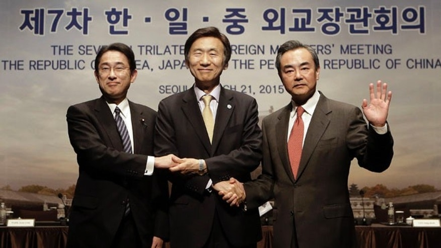 Mar. 21, 2015: From right, Chinese Foreign Minister Wang Yi, South Korean Foreign Minister Yun Byung-se and Japanese Foreign Minister Fumio Kishida pose during the 7th trilateral foreign ministers' meeting in Seoul, South Korea. (AP)