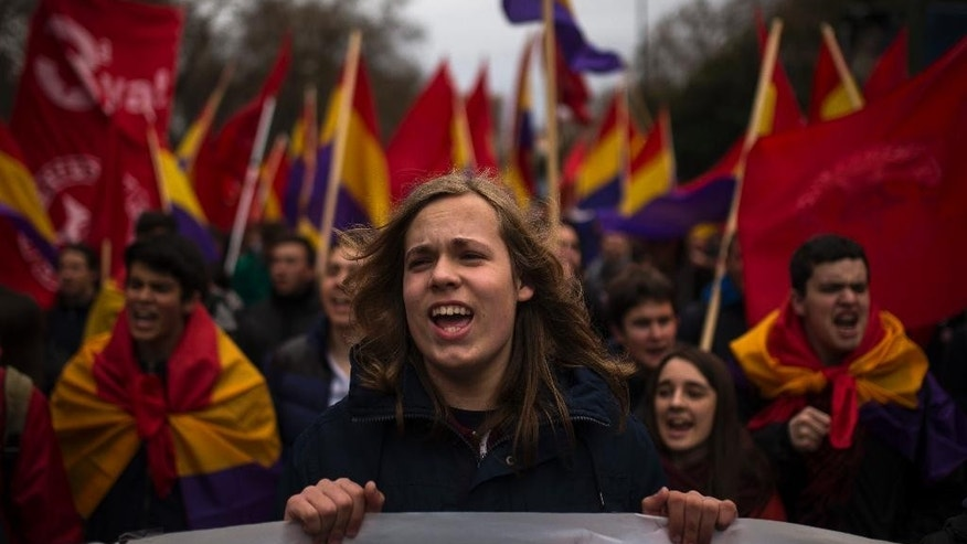 "Protestors shout slogans during a ""Dignity March"" to protest against the Government in Madrid, Spain, Saturday, March 21, 2015. Thousands from different parts of Spain marched towards the Capital to join a large anti-austerity demonstration to express their anger at government financial cuts, its housing rights policies, and the high unemployment rates and to protest the Transatlantic Trade and Investment Partnership (TTIP) a proposed free trade agreement between the European Union and the United States. (AP Photo/Andres Kudacki)"