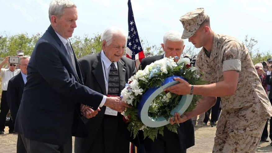 Mar. 21, 2015: U.S. veterans offer a wreath during a ceremony commemorating the 70th anniversary of the Battle of Iwo Jima on Iwo Jima, now known officially as Ioto, Japan. (AP)