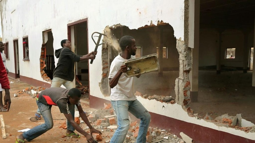 FILE - In this Tuesday, Dec. 10, 2013 file photo, a Christian mob attacks a mosque in Bangui, Central African Republic. Ten mosques have reopened in Central African Republic's capital, Bangui, as Muslims begin to trickle back home after months of sectarian violence. (AP Photo/Jerome Delay, File)
