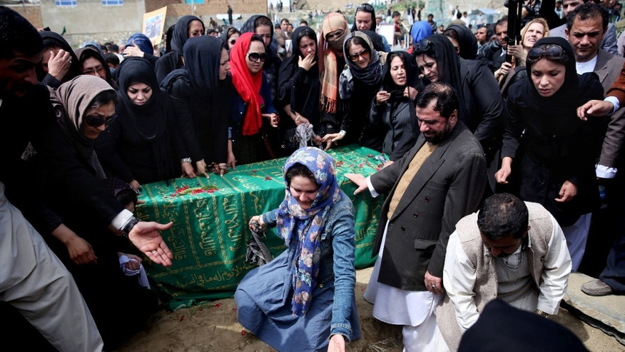 March 22, 2015: Civil society activists and relatives gather around the coffin of 27-year-old Farkhunda, an Afghan woman who was beaten to death by a mob, during her funeral.