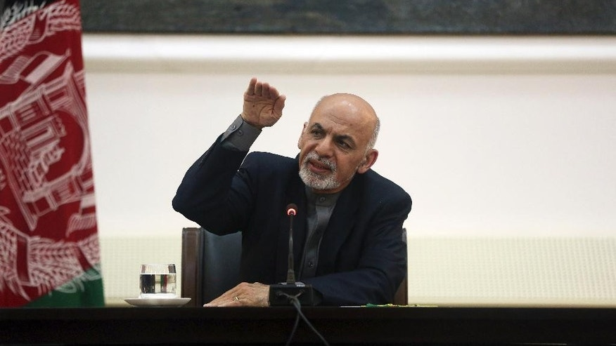 "Afghanistan's President Ashraf Ghani talks during a press conference for foreign media at the presidential palace in Kabul, Afghanistan, Saturday, March 21, 2015. ""The Daesh character is that it is like a maneater,"" Ghani told reporters there, using an acronym for the Islamic State group. ""It swallows its competitors. What it did to the Syrian National Army is one example."" (AP Photo/Massoud Hossaini)"