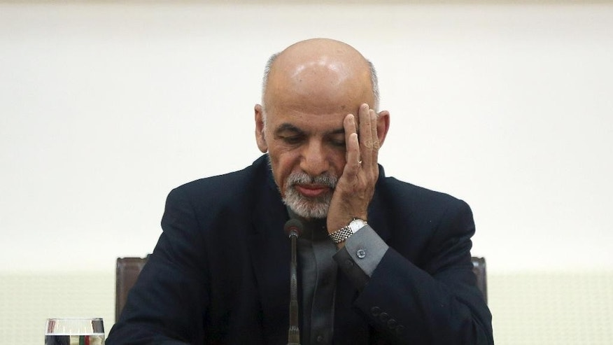 "Afghanistan's President Ashraf Ghani listens to a journalist during a press conference for foreign media at the presidential palace in Kabul, Afghanistan, Saturday, March 21, 2015. ""The Daesh character is that it is like a maneater,"" Ghani told reporters there, using an acronym for the Islamic State group. ""It swallows its competitors. What it did to the Syrian National Army is one example."" (AP Photo/Massoud Hossaini)"