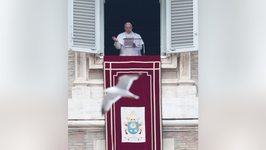 Pope Francis speaks during the Angelus prayer he delivered from his studio window overlooking St. Peter's Square at the Vatican, Sunday, March 22, 2015. (AP Photo/Alessandra Tarantino)