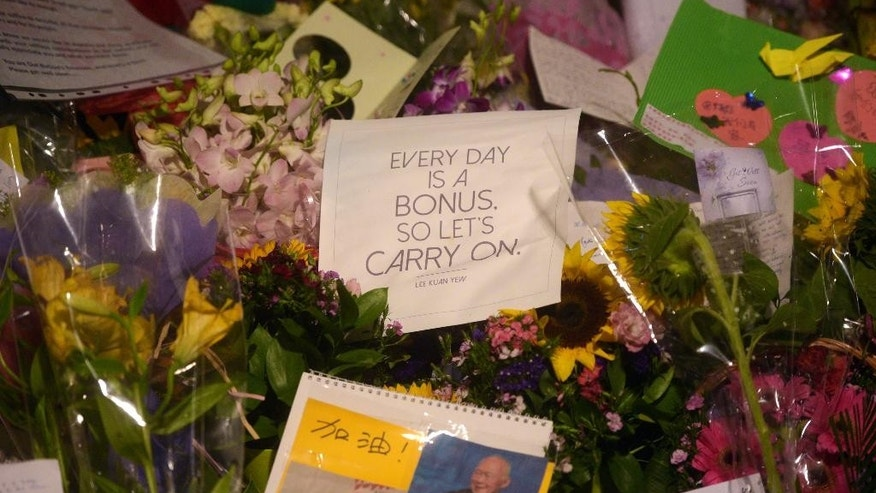 A quote attributed to Singapore's founding Prime Minister Lee Kuan Yew lies among earlier messages of support for him at the hospital where he passed away on Monday, March 23, 2015 in Singapore. Lee Kuan Yew, who founded modern Singapore and was both feared for his authoritarian tactics and admired for turning the city-state into one of the world's richest nations, died Monday, the government said. He was 91. (AP Photo/Joseph Nair)