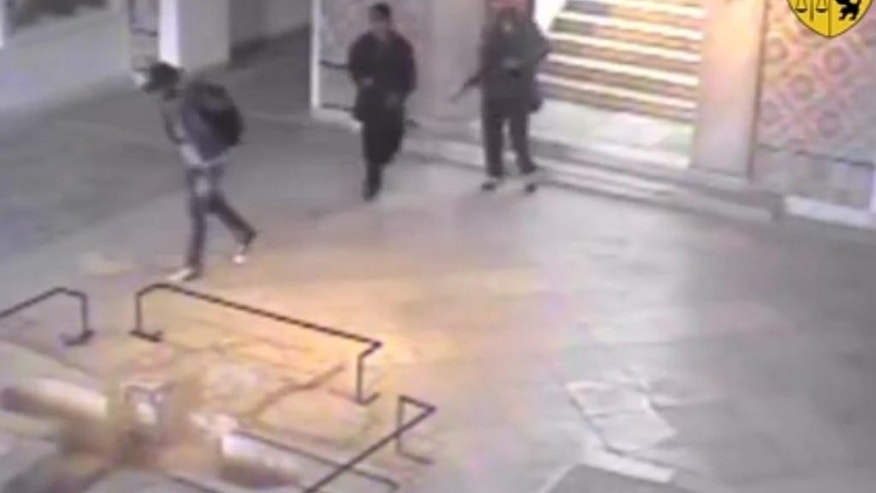 March 18, 2015: This frame grab from a video released by Tunisia's Interior Ministry shows the gunmen walking through the National Bardo museum during the attack that killed 21 people. (AP/Tunisia's Interior Ministry)