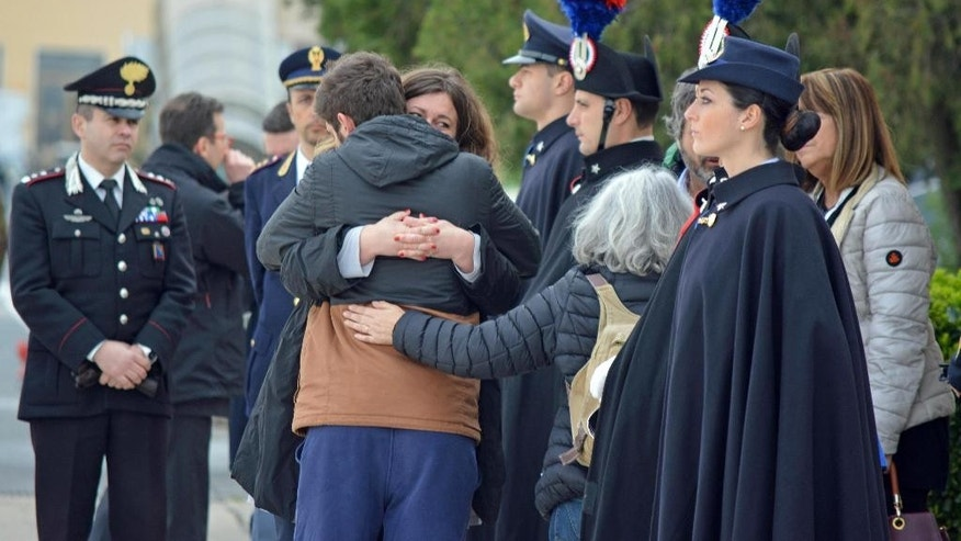 Relatives of the Italian victims of Tunis' National Bardo museum attack hug each other as the bodies of the four Italians who were killed in the attack arrived at the Ciampino airport near Rome, Saturday, March 21, 2015. (AP Photo/Telenews, Ansa)