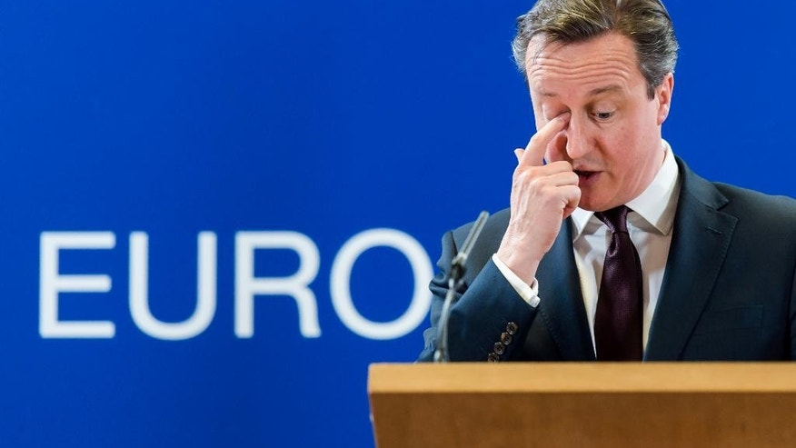 British Prime Minister David Cameron addresses the media after an EU summit in Brussels on Friday, March 20, 2015. EU leaders on Friday are looking to back U.N.-brokered efforts to form a national unity government in conflict-torn Libya that may include a possible mission to help provide security. (AP Photo/Geert Vanden Wijngaert)