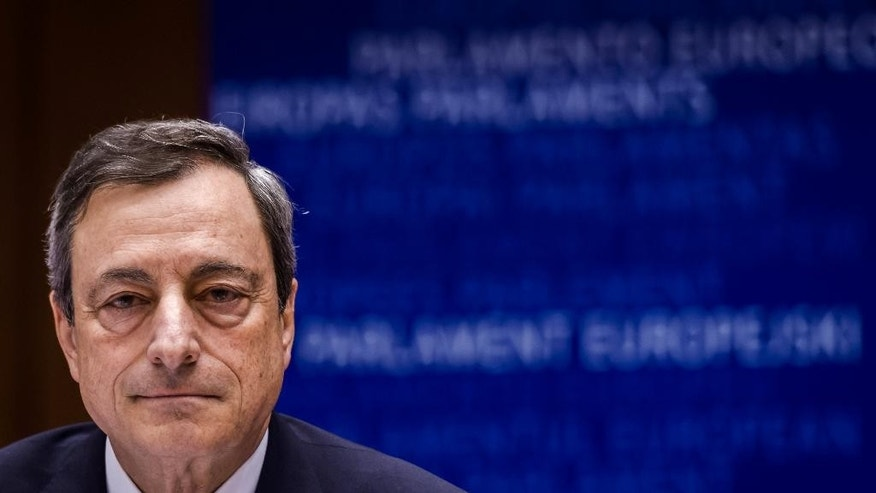 European Central Bank Governor Mario Draghi talks during an Economic Affairs Committee meeting at the European Parliament in Brussels on Monday, March 23, 2015.  Draghi presented the ECB's perspective on economic and monetary developments. (AP Photo/Geert Vanden Wijngaert)