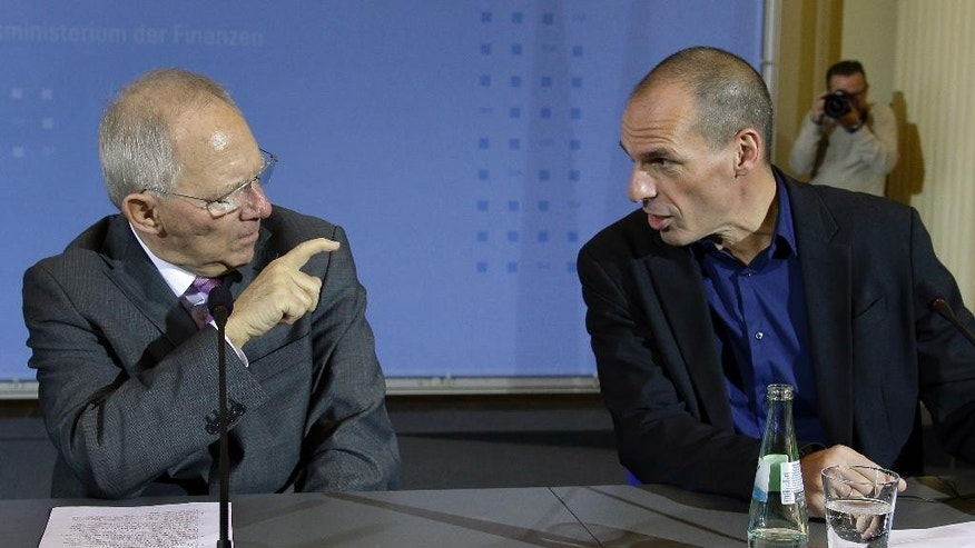 FILE - The Feb 5, 2015 file photo shows German Finance Minister Wolfgang Schaeuble, left, pointing a finger to the Finance Minister of Greece, Yanis Varoufakis, right, during a joint press conference as part of a meeting in Berlin, Germany. Relations between Greece's new government and Germany have got off to a rocky start after Prime Minister Alexis Tsipras swept to power in January on pledges to end German-backed austerity. Here is a glance at some of the issues that are causing friction as Tsipras makes his first visit to Berlin to meet Chancellor Angela Merkel. (AP Photo/Michael Sohn, file)