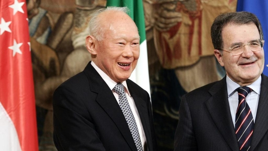 FILE - In this May 17, 2007, file photo,  Singapore's then former Prime Minister Lee Kuan Yew, left, is greeted by Italian Premier Romano Prodi, right, at the Chigi Premier's palace in Rome. Lee brought prosperity to Singapore with an authoritarian system designed to outlast him, but that legacy may be ill-suited for the 21st-century challenges facing the tropical city-state. One of the last of a generation of Southeast Asian strongmen, Lee died Monday, March 23, 2015,  at age 91. (AP Photo/Plinio Lepri, File)