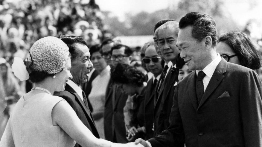 FILE - In this Feb. 18, 1972, file photo, Singapore's then Prime Minister Lee Kuan Yew, right, shakes hands with Britain's Queen Elizabeth II, as she arrived in Singapore during her tour of the Far East.  Lee brought prosperity to Singapore with an authoritarian system designed to outlast him, but that legacy may be ill-suited for the 21st-century challenges facing the tropical city-state. One of the last of a generation of Southeast Asian strongmen, Lee died Monday, March 23, 2015,  at age 91. (AP Photo/ Max Nash, File)