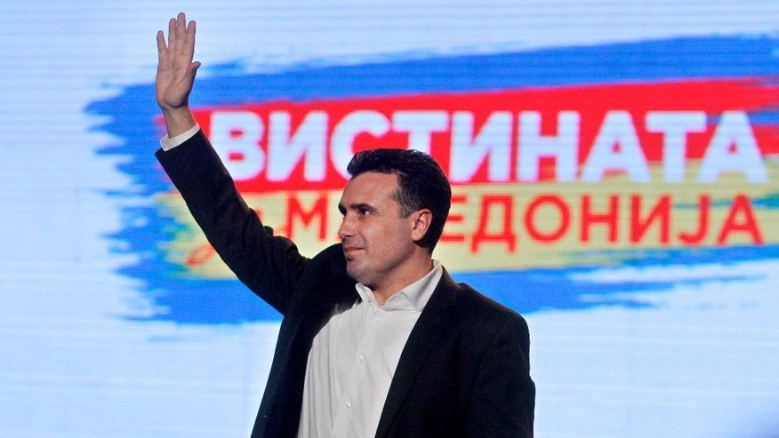 "In this photo taken Wednesday, March 10, 2015, the leader of the opposition Social-Democratic Alliance of Macedonia Zoran Zaev greets his supporters on a political gathering in Skopje, Macedonia. Nearly weekly revelations about wiretapped conversations have spun a web of shock and fascination among ordinary Macedonians, hammering the Balkan country's politics and sharply splitting its society. The affair has triggered warnings from the European Union, which has been weighing Macedonia's membership bid for more than a decade. As debate fills social media, people on both sides separate supporters and opponents into ""patriots"" or ""traitors."" (AP Photo/Boris Grdanoski)"