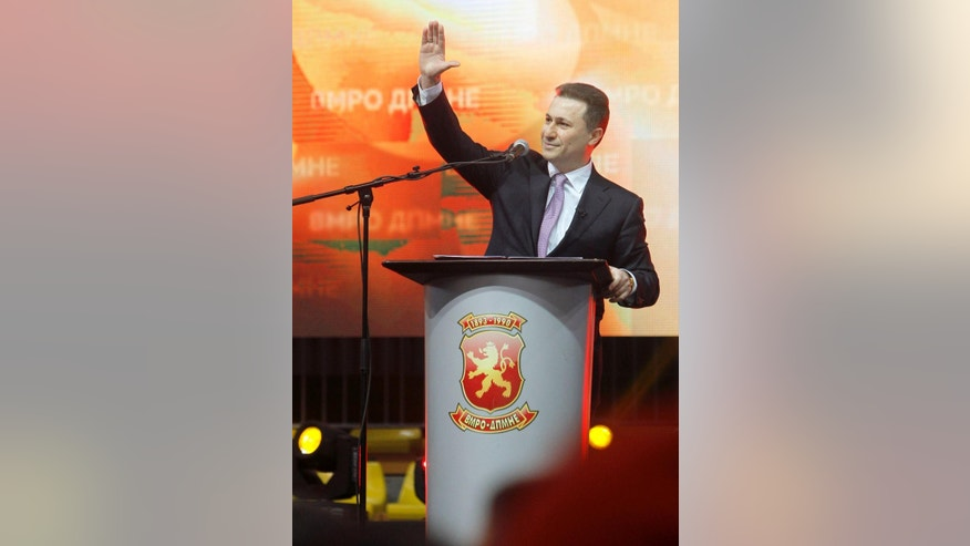"In this photo taken on Sunday, March 15, 2015, Macedonian Prime Minister and leader of the ruling center-right VMRO-DPMNE party Nikola Gruevski greets supporters at the party's gathering in the capital Skopje, Macedonia. Nearly weekly revelations about wiretapped conversations have spun a web of shock and fascination among ordinary Macedonians, hammering the Balkan country's politics and sharply splitting its society. The affair has triggered warnings from the European Union, which has been weighing Macedonia's membership bid for more than a decade. As debate fills social media, people on both sides separate supporters and opponents into ""patriots"" or ""traitors."" (AP Photo/Boris Grdanoski)"