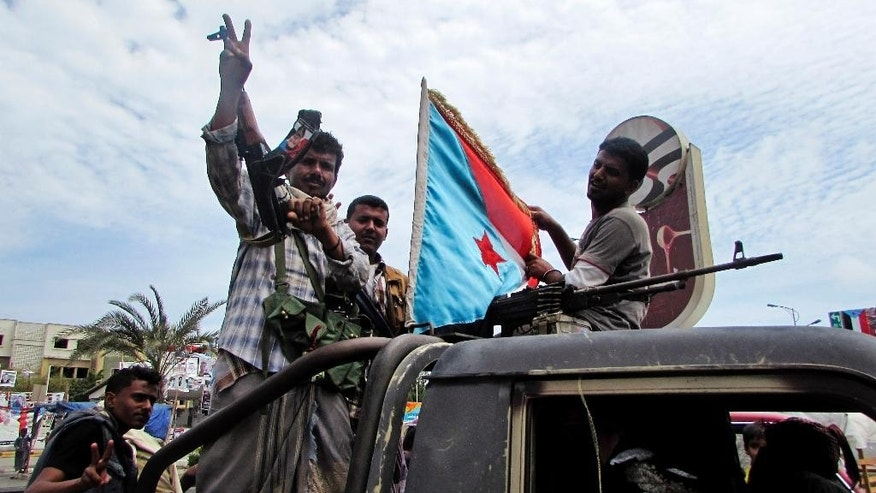 FILE - In this Friday, March 20, 2015 file photo, militiamen loyal to President Abed Rabbo Mansour Hadi ride on an army vehicle on a street in Aden, Yemen. Yemen's Shiite rebels, backed by supporters of former President Ali Abdullah Saleh, have seized the third-largest city after capturing the capital Sanaa in September, effectively splitting the country in half and hindering U.S. efforts to combat a powerful local al-Qaida affiliate. Hadi, a close U.S. ally, fled house arrest in Sanaa last month and has set up a base in the port city of Aden, the former capital of the once-independent south. (AP Photo/Yassir Hassan, FIle)