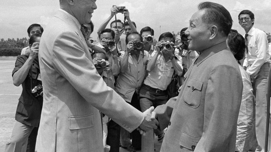 "In this Nov. 12, 1978 photo released by China's Xinhua news agency, Lee Kuan Yew, left, welcomes then-Chinese Vice Premier Deng Xiaoping in Singapore. Chinese leaders admired modern Singapore's founder Lee for his toughness, economic pragmatism and insistence on respect for authority. In many ways, Lee's model of ""Asian values,"" combining authoritarianism and economic planning, became China's own blueprint for modernity. Most significantly, late Chinese leader Deng looked to Singapore, with its ethnic Chinese majority, as he embarked on his country's economic reforms in the late 1970s. Those changes would spur three decades of rapid growth and lift China from the grinding poverty and political dysfunction that were legacies of Mao Zedong's centrally planned economy. Lee, who died Monday, March 23, 2105 at age 91, and Deng established a close relationship during their several meetings, sharing a starkly practical approach, hard-headed manner and similarly ruthless bent when their wills were defied. (AP Photo/Xinhua, Zhang Guiyu) NO SALES"