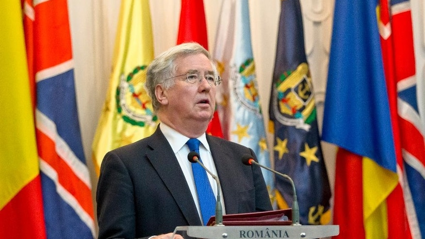 Britain's Defense Secretary Michael Fallon speaks to media at the Romanian defence ministry headquarters in Bucharest, Romania, Monday, March 23, 2015. Fallon said NATO members Romania and Britain will not be intimidated by threats against members of the military alliance, referring to Russia's ambassador to Denmark, Mikhail Vanin's remarks this weekend that Danish warships could become targets for Russian nuclear missiles if the Danes join the alliance's missile defense system.(AP Photo/Vadim Ghirda)