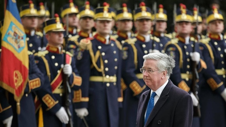 Britain's Defense Secretary Michael Fallon reviews an honor guard in Bucharest, Romania, Monday, March 23, 2015. Fallon said NATO members Romania and Britain will not be intimidated by threats against members of the military alliance, referring to Russia's ambassador to Denmark, Mikhail Vanin's remarks this weekend that Danish warships could become targets for Russian nuclear missiles if the Danes join the alliance's missile defense system.(AP Photo/Vadim Ghirda)