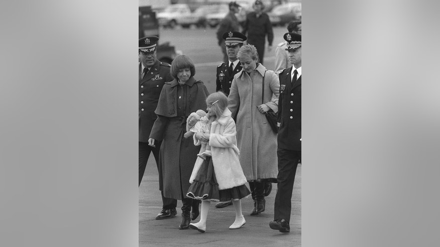 FILE - The March 29, 1985 file photo shows Karyn Nicholson looking down to her 8-year-old daughter Jenny when walking on tarmac to board US Air Force jet bearing the body of US Maj. Arthur D. Nicholson Jr. before it left for the United States at Frankfurt's, West Germany, Rhein-Main airport. A Soviet sentry had shot and killed unarmed U.S. Maj. Arthur Nicholson, letting him bleed out where he fell next on the tank firing range he had been reconnoitering when he was on a patrol into communist East Germany as allowed by postwar agreements. (AP Photo/Kurt Strumpf)