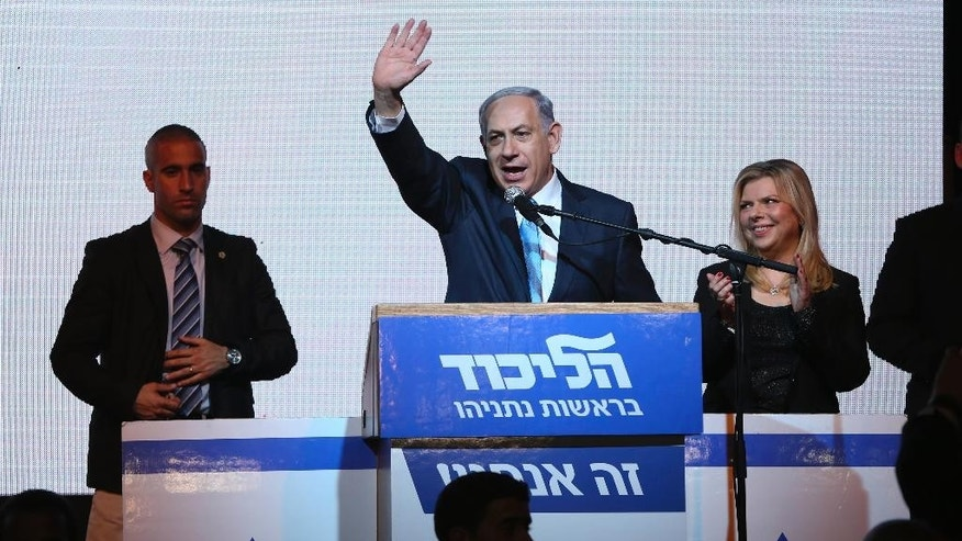 FILE - In this Tuesday, March 17, 2015 file photo, Israeli Prime Minister Benjamin Netanyahu greets supporters at the party's election headquarters in Tel Aviv. After a strong performance in last week's parliamentary election, Netanyahu seems to be cruising toward forming a new government of hardline and religious parties. But in the smoke-and-mirrors world of Israeli politics, a centrist government more amenable to peace negotiations could easily emerge at the last minute instead. (AP Photo/Oded Balilty, File)